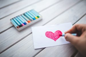hand-with-oil-pastel-draws-the-heart-6333